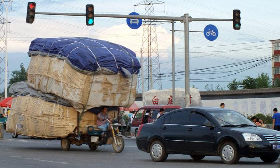 Store-and-More-moving-miscue-china-motorcycle-cargo-stacked